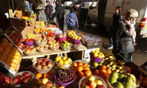 Fruit stalls and shops in Govanhill in Glasgow. Currently just 8% of children aged 11-18 achieve government targets of consuming five portions of fruit and vegetables a day.