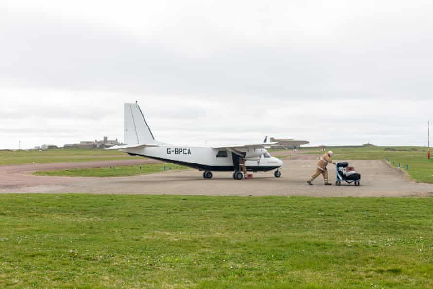 Muir greets the plane from Kirkwall on the Orkney mainland