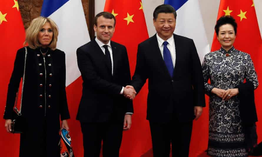 Emmanuel Macron and his wife Brigitte, left, meet with Xi Jinping and his wife Peng Liyuan.