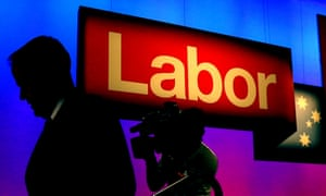bill shorten seen in silhouette, leaves the stage at the labor national conference