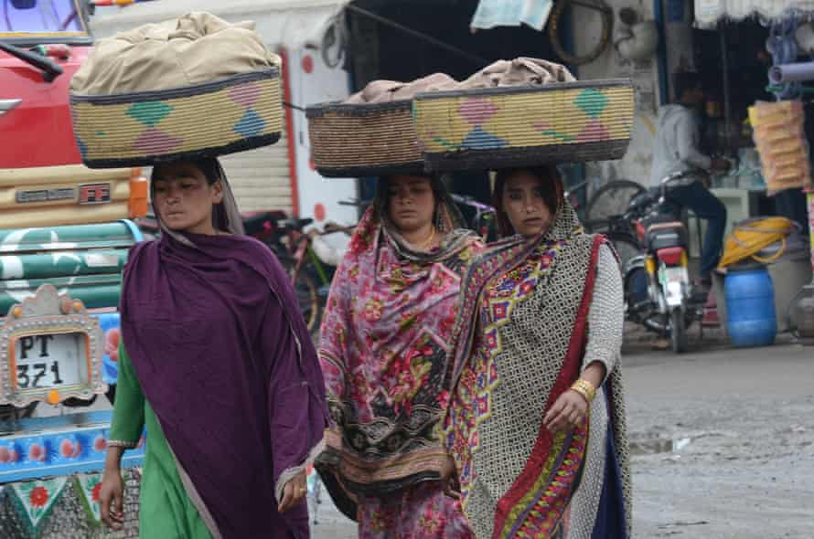 Women in Lahore go about their work on the eve of International Women's Day