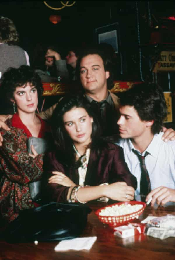Elizabeth Perkins (left) with Demi Moore, Jim Belushi and Rob Lowe in her debut film, 1986's About Last Night