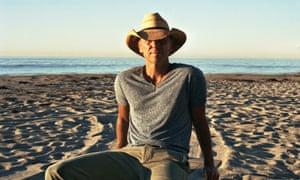 Sun, sea and stetsons: Chesney on the beach.