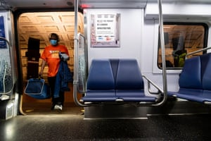 A passenger wearing a face mask boards the Metro Red Line subway in Washington on May 1, 2020.