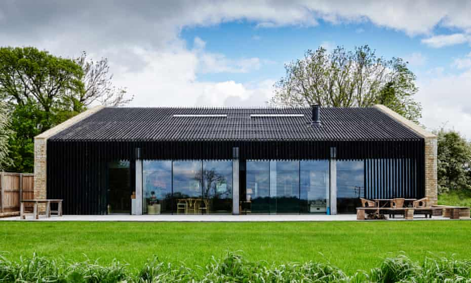 The black barn with floor-to-ceiling windows