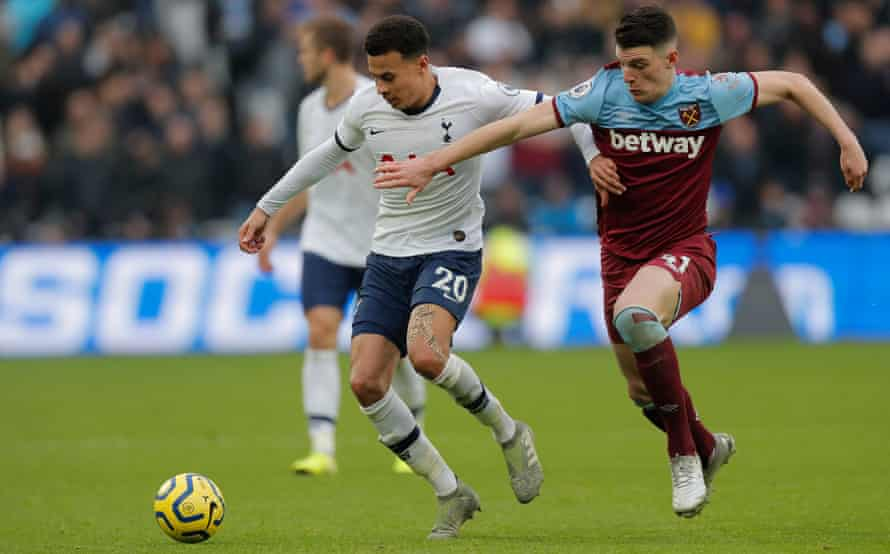 Dele Alli tussles for the ball with Declan Rice.