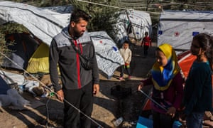 Salam Aldeen, the founder of Team Humanity, with children at the camp on Lesbos