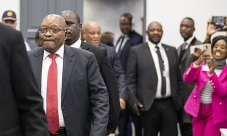 Jacob Zuma (in red tie) arrives to give testimony