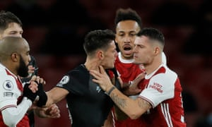 Granit Xhaka grabs Burnley's Ashley Westwood to earn a red card.