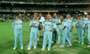 England's beaten players look on as Pakistan are given the World Cup in 1992.