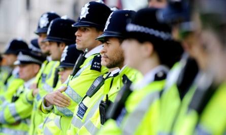 Row of police in hi-vis uniforms