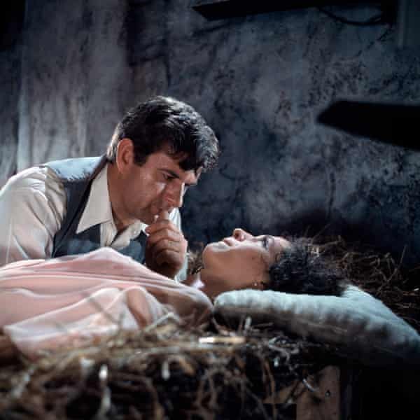 Leon Greene and Niké Arrighi in the Hammer horror film The Devil Rides Out, 1967.