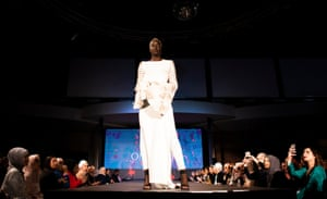 A model wears an Omi Kay Couture design