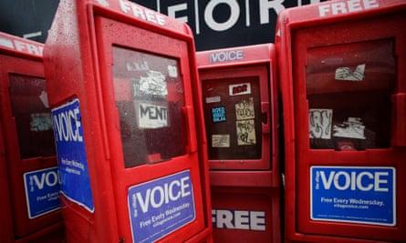 Empty newspaper racks for The Village Voice in Manhattan.