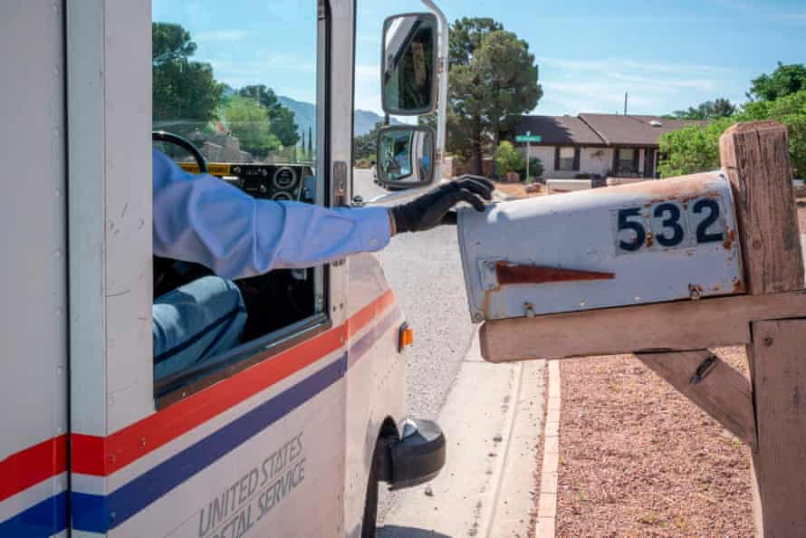 A USPS worker delivers mail in El Paso, Texas, during the pandemic.
