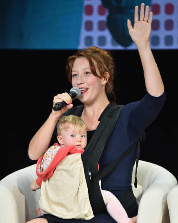 The Women's March national co-president Bob Bland with her child on stage at Global Citizen: Movement Makers.