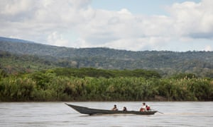 Locals take a boat along the Ene River in the Peruvian rainforest.