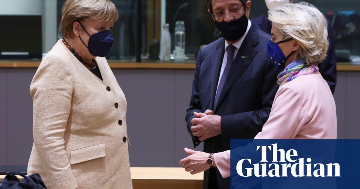 Merkel hesitates over handshake with EU's Ursula von der Leyen – video