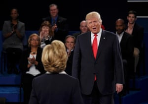 Trump sneers at Clinton.
