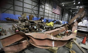 Twisted beams and other remains from the attacks at the World Trade Center sit in JFK airport in 2011.