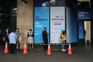 People queue at a Covid testing clinic in Sydney after the new cases were reported
