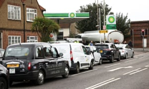 Vehicles queue to refill at a BP petrol station in Waltham Abbey, Britain, which was restocked today