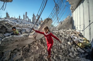 Children climb on the rubble of a building in the Jarabulus district of Aleppo.