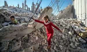 Children in the rubble of a building in the Jarabulus district
