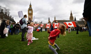 Children play at the protest held by foreign nationals, living in the UK