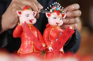 Linyi, China A folk artist makes dough figurines