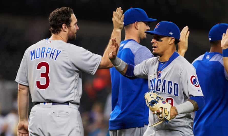 Daniel Murphy pictured with his new team-mates after the Cubs' win over Detroit.