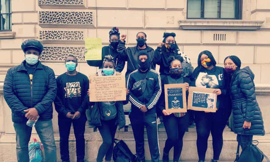 Chantelle (centre, back) with her friends at the protest in London on Sunday.