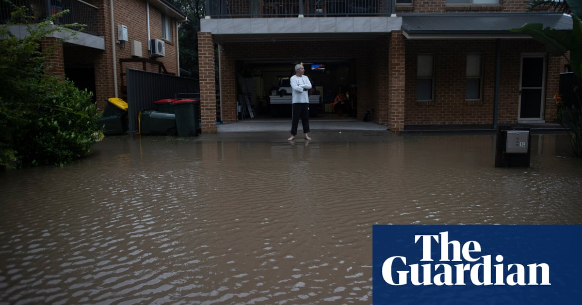 'Never seen anything like it': locals watch helplessly as floodwaters rise across NSW – The Guardian