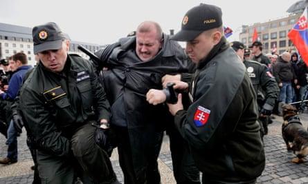 Slovak police detaining Marian Kotleba during a rally in Bratislava in 2009.