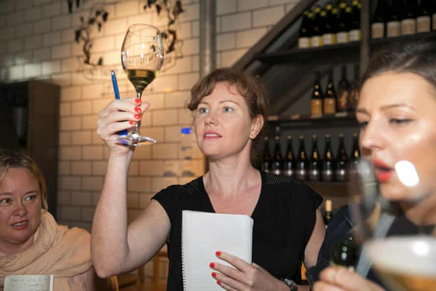 Gabrielle Jackson looks into a glass at a wine tasting at Nomad restaurant, Sydney