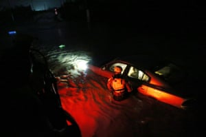 A rescue team from the local emergency management agency inspects flooded in Fajardo, Puerto Rico.
