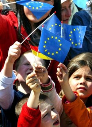 Children waving German and EU flag