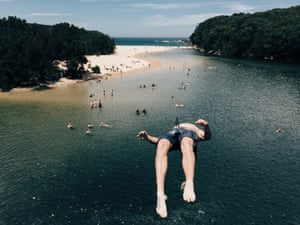 A close-up image of a diver as he falls backwards into water at the Royal national park near Sydney, Australia. Taken by Annette Widitz