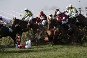Davy Russell riding Tiger Roll (centre, maroon & white cap) clears The Chair.