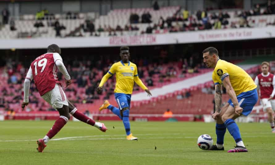 Nicolas Pepe (left) scores his and Arsenal's second goal in their 2-0 win against Brighton.