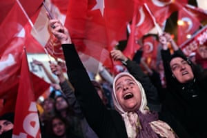 Istanbul, Turkey A supporter of the Turkish president waves a national flag as she celebrates the results of a nationwide referendum