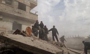 Civil defence workers carry a wounded man after airstrikes in East Ghouta, Damascus, 6 February.
