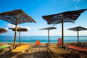parasols at beach of paliochori milos greece.