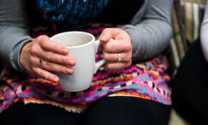 A woman hold a cup of coffee