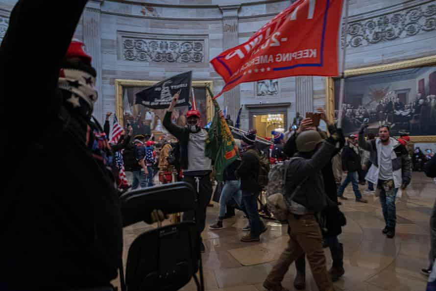 Follow the flag … pro-Trump supporters breach the US Capitol building on 6 January.
