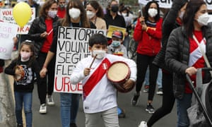 Several parents in the company of their children and supporters participate in a march to ask for the return to the classrooms, in Lima, Peru. Face-to-face classes were suspended at the start of the school year in March 2020 and the Peruvian government has not announced plans for their return due to Covid-19 fears.