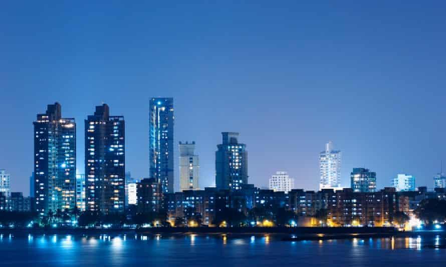 Mumbai's buildings lit up at dusk.