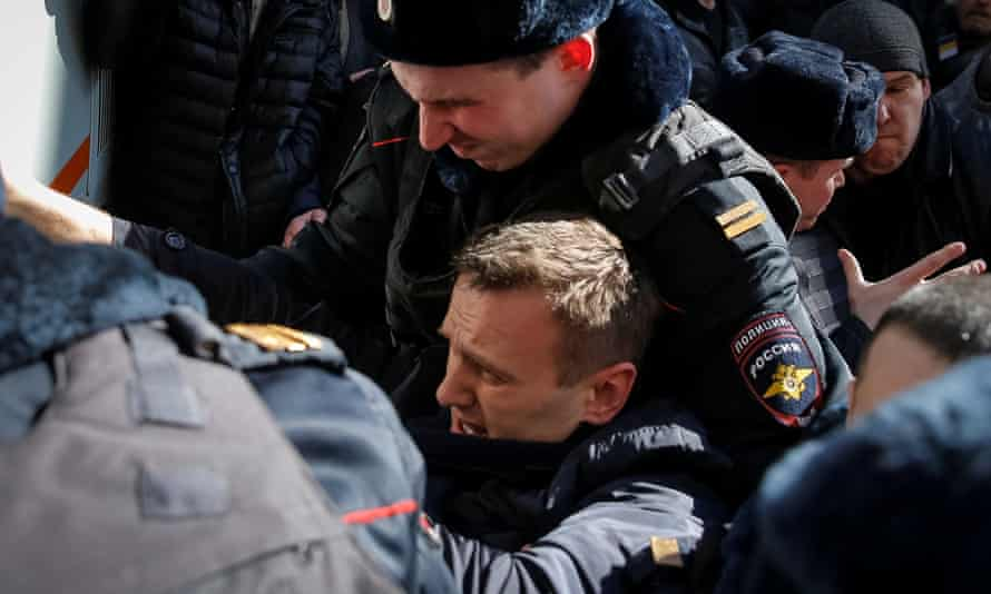 Alexei Navalny is arrested at a rally in Moscow on Sunday.