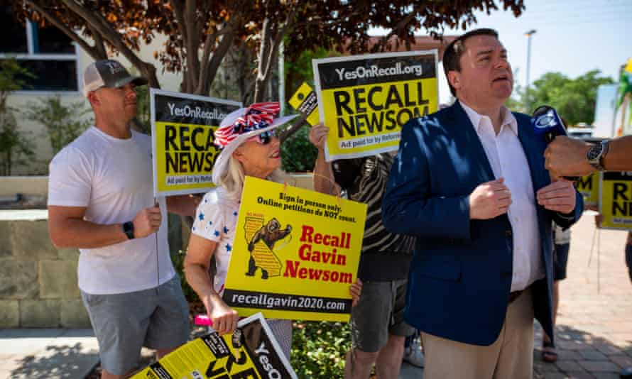 Carl DeMaio, chair of Reform California, speaks during a television interview before a pro-recall rally in Santa Clarita on 15 August.