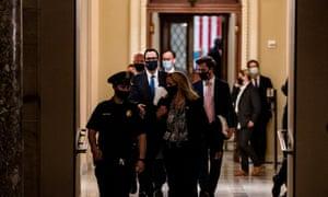 Treasury Secretary Steven Mnuchin (in glasses) walking to Nancy Pelosi's office on Capitol Hill in July.